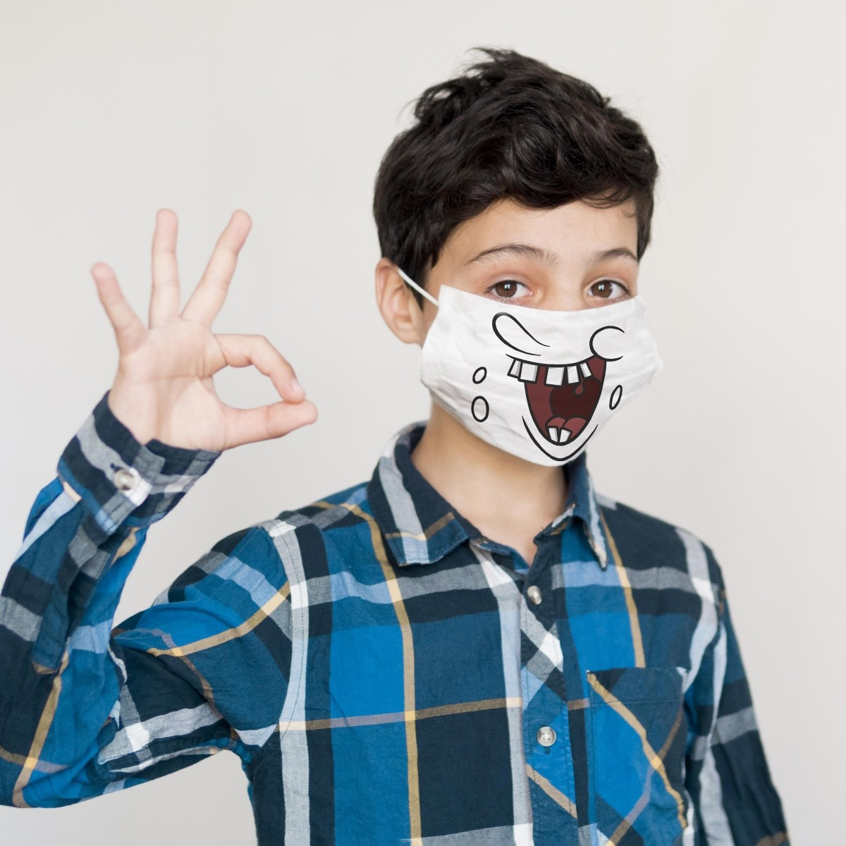 Young boy wearing a certified Fun Smile child's social mask