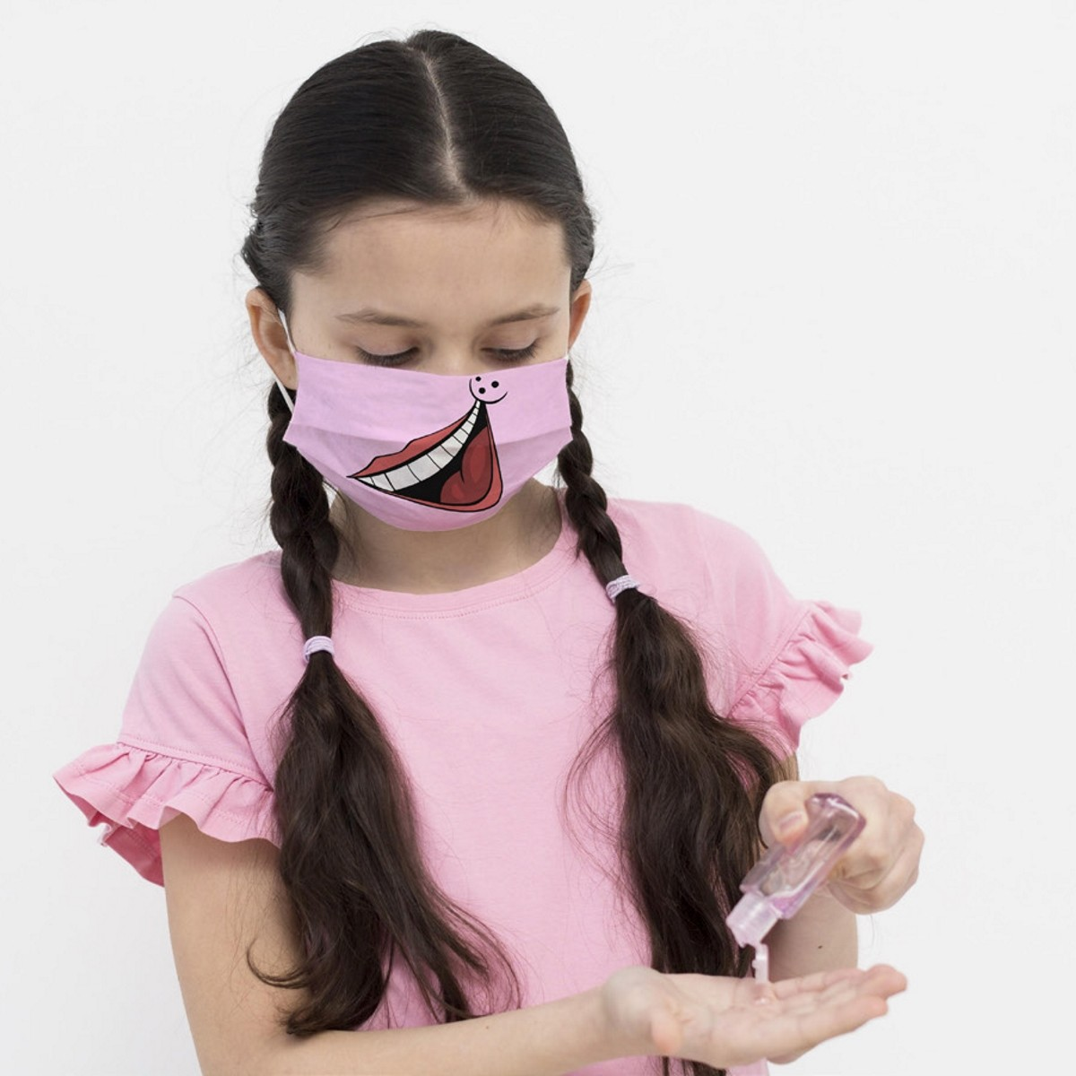 Young girl wearing Big Smile certified child face mask
